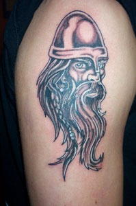 Small tattoo of viking warrior head