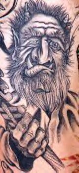 Viking tattoo of warrior with horns and big teeth