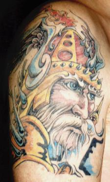 Colorful viking warrior with white beard tattoo