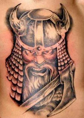 Angry viking warrior in horned helmet tattoo