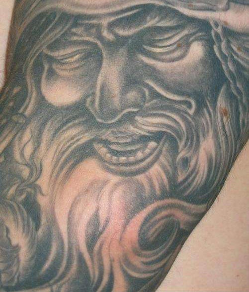 Smiling viking with closed eyes tattoo