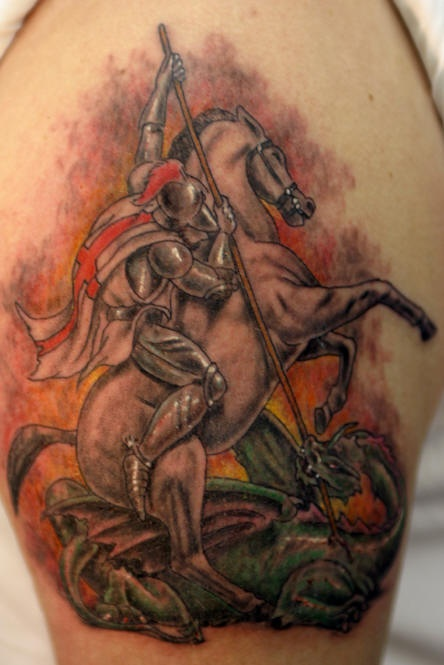 Warrior on horse slaying dragon tattoo