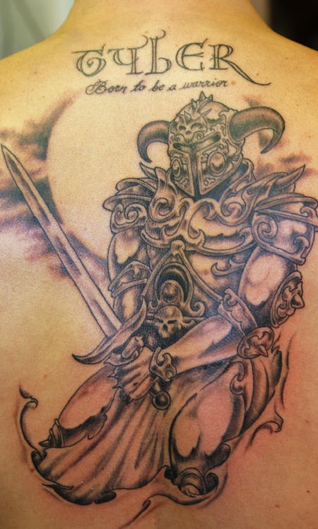 Back tattoo of warrior with sword