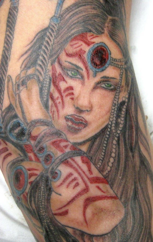 Warrior tattoo of girl with red signs on body