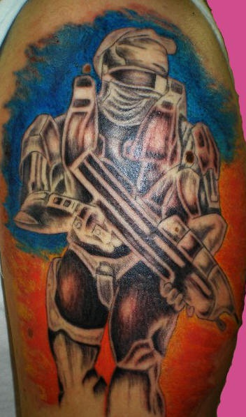 Tattoo of strong warrior with firearm