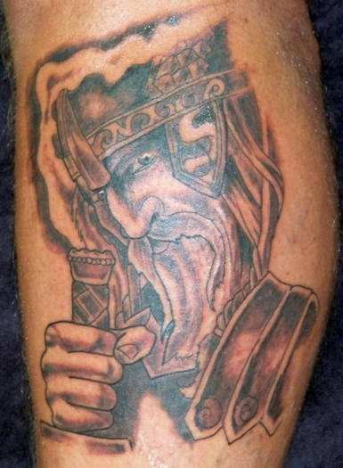 Tattoo of wise warrior with long beard
