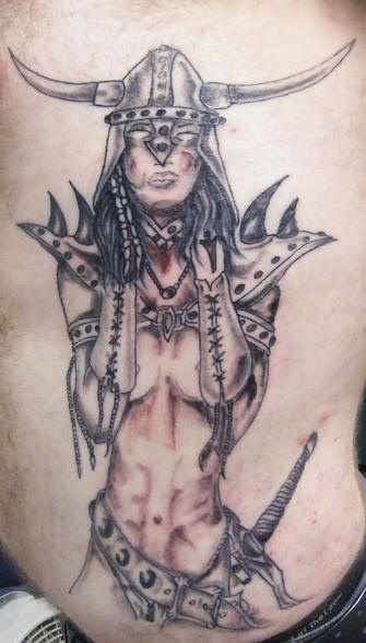 Naked female warrior tattoo in horned helmet