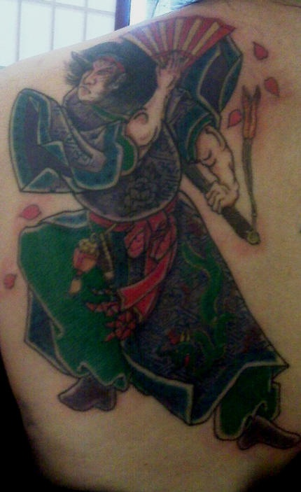 Japanese warrior with fan in green form tattoo