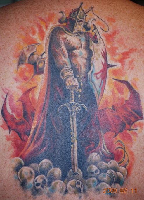 Power tattoo of warrior standing on skulls