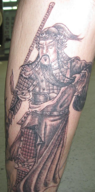 Big asian warrior tattoo with spear