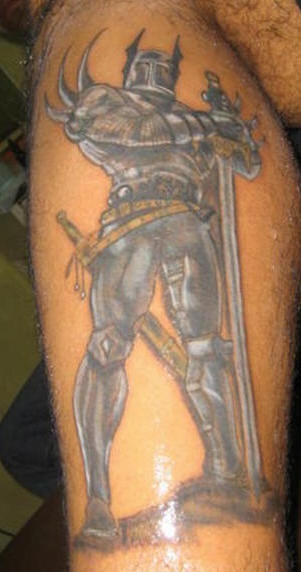 Warrior in armor with long sword tattoo