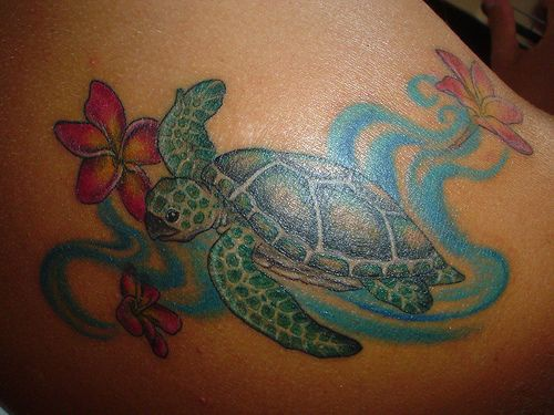 Tattoo with green turtle and flowers