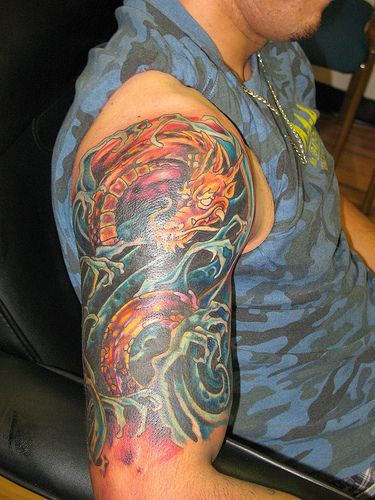 Tattoo with water dragon in waves on whole hand