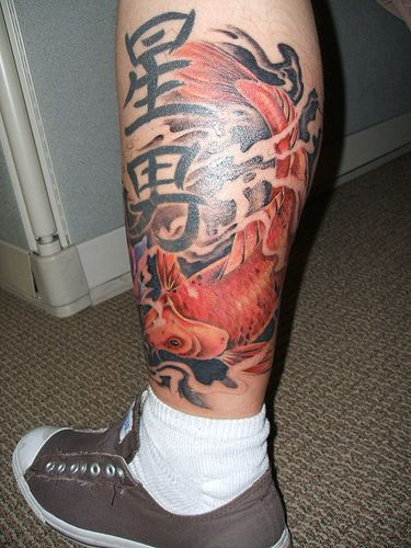 Leg tattoo with goldfish and character