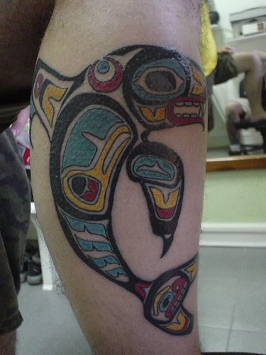 Colored leg tattoo with whale in cool style