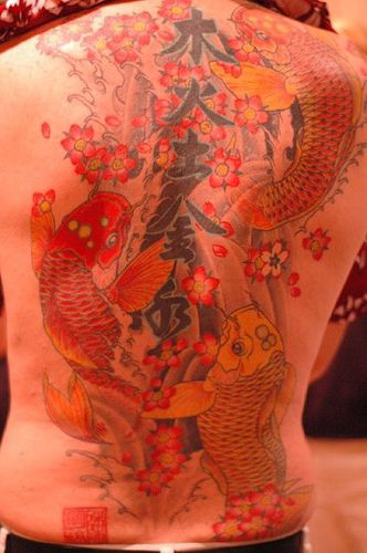 Tattoo with goldfishes and characters on whole back