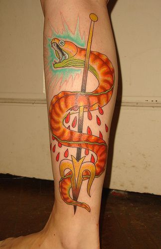 Tattoo with big snake killed by trident