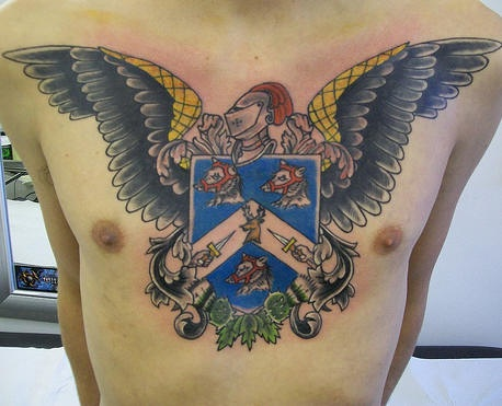 Winged crest tattoo in colour