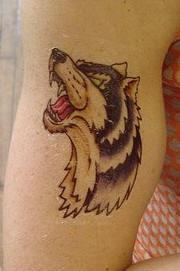 Cryin wolf tattoo in a cartoon style