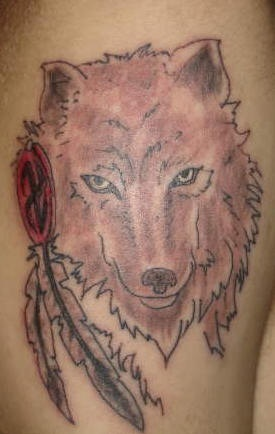 Nice wolf tattoo with feather