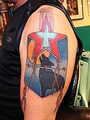 Colored wolf tattoo with a red star
