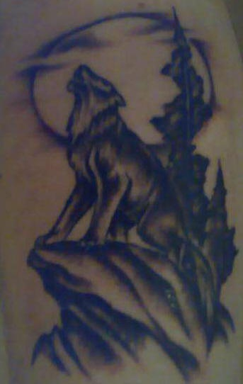Tattoo with howling wolf on the rock
