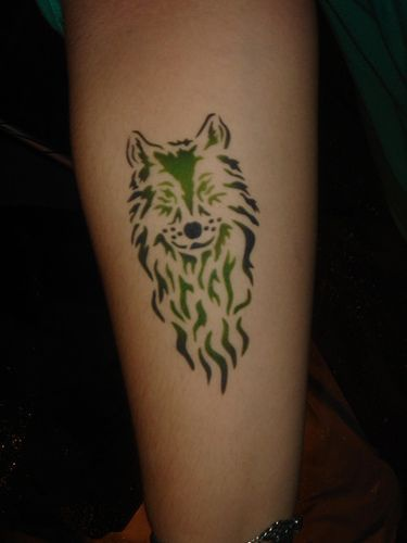 Small wolf head tattoo on hand