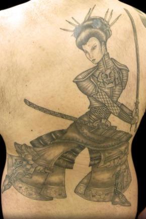 Black woman warrior tattoo on back
