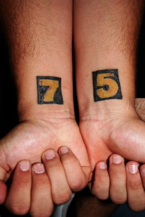 Seven and five tattoo on both wrists