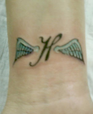 Wings tattoo on inner side of hand
