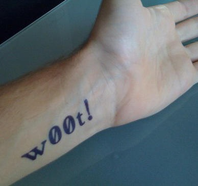 Woot writing on wrist tattoo