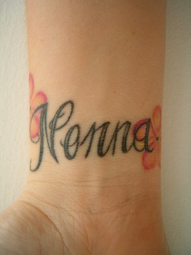 Calligraphic tattoo with word Nonna on inner side of hand