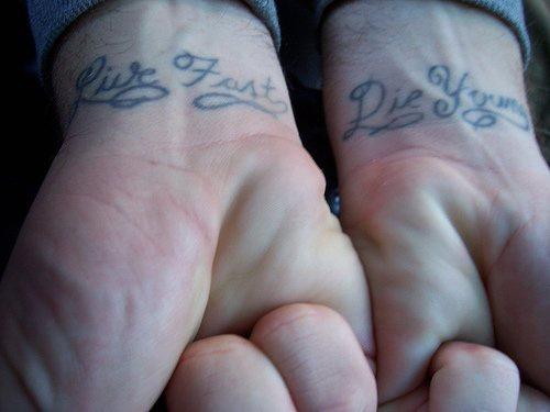 Calligraphic tattoo on both wrists