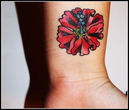 Coloured flower inner wrist tattoo