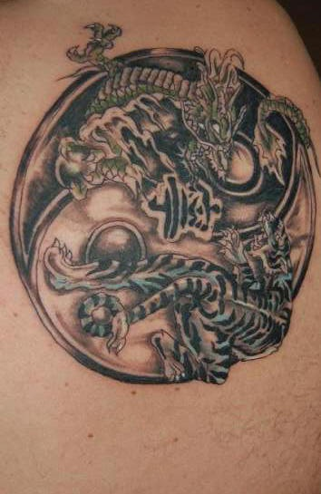Black yin yang tattoo with dragon and tiger