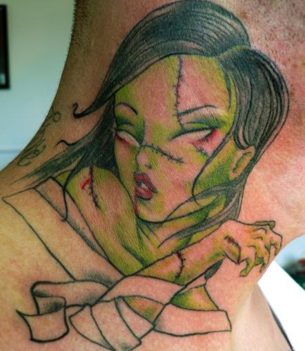 Zombie girl tattoo on neck