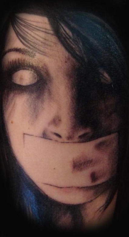 Zombie taped mouth tattoo