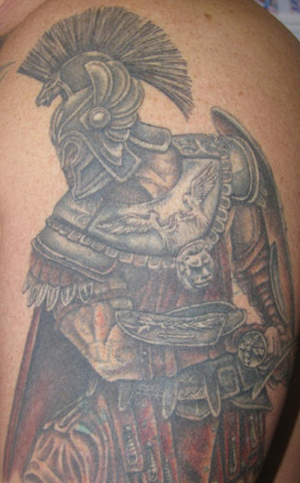 Tattoo of armored warrior with two birds on back