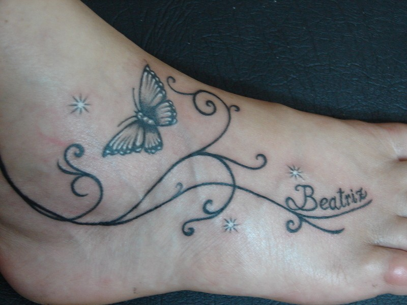 Tattoo of butterfly on foot