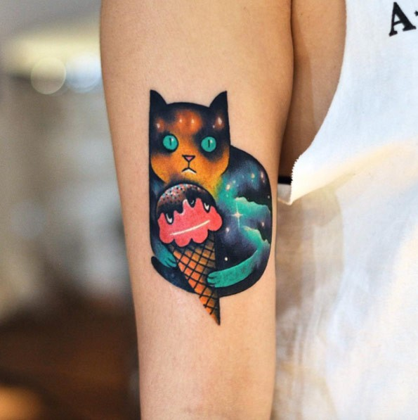 Tattoo painted by David cote on arm of cat with ice-cream