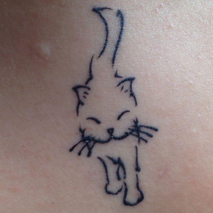 Minimalistic stepping cat tattoo