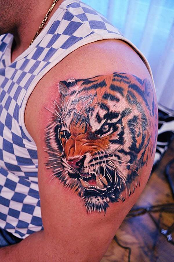 Realistic tiger head on shoulder tattoo