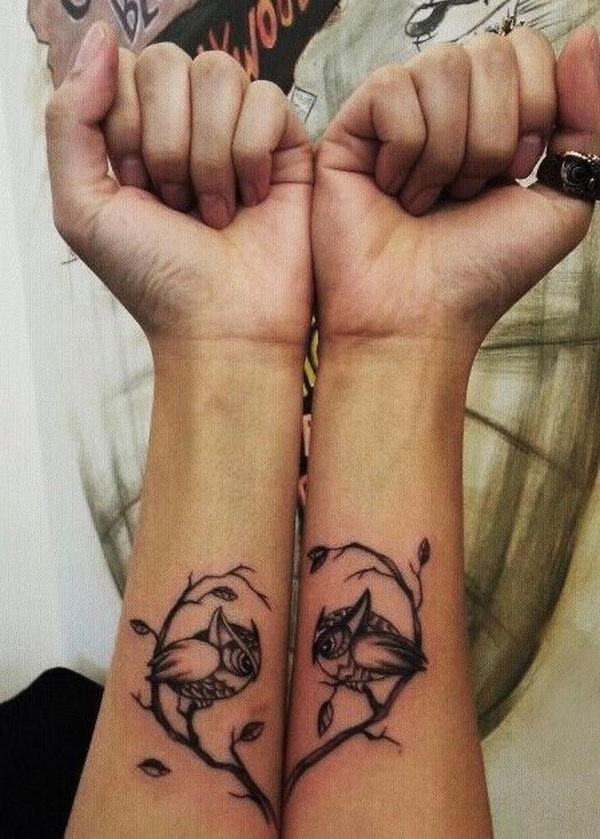 Tattoo with owls on forearms