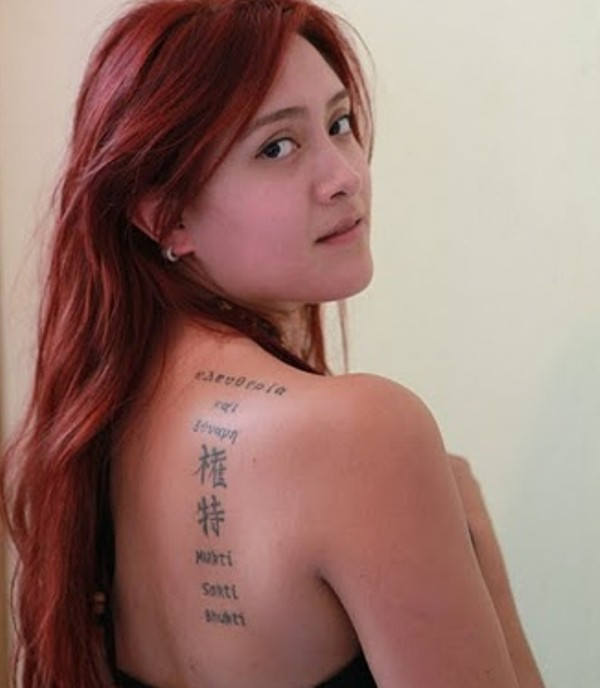 Tattoo with words and chinese symbols on shoulder