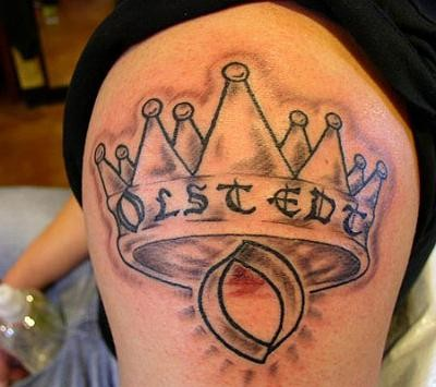 Tattoo on shoulder crown and letter o