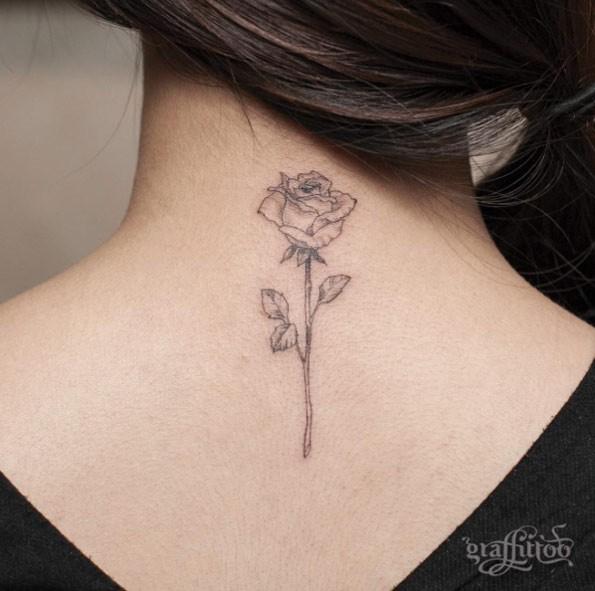 Tender pale ink rose flower detailed upper back tattoo