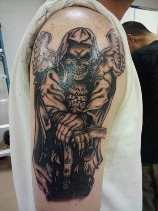 Terrible death with a scythe tattoo on shoulder