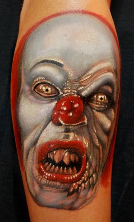 Terrible half clown half monster tattoo