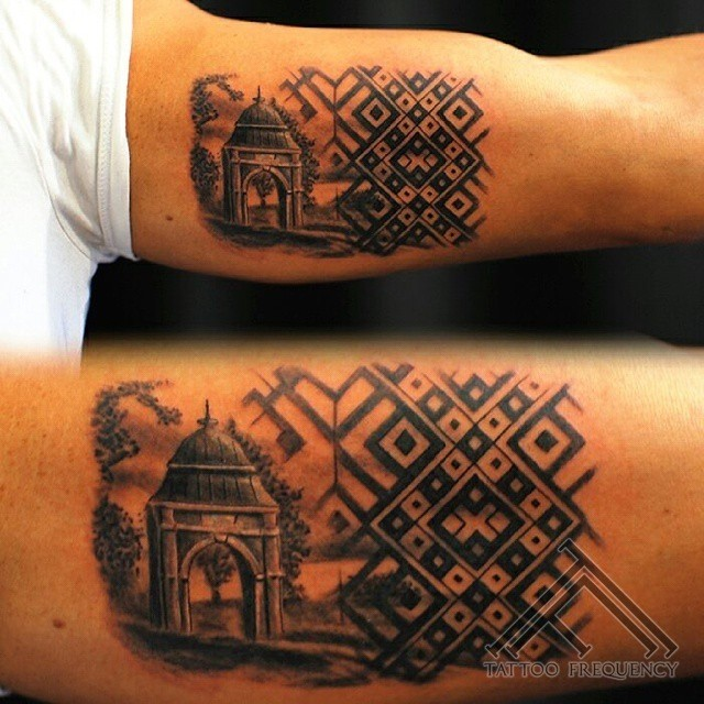 Terrific painted black and white old gate with ornaments tattoo on arm