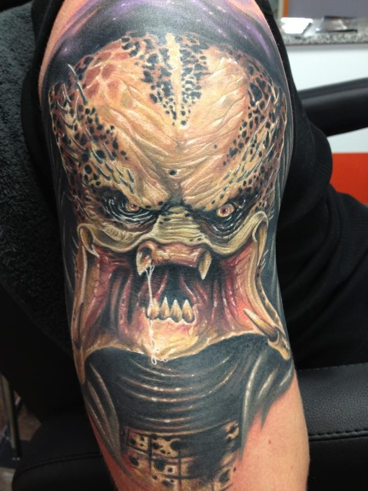 Terrifying 3D realistic naturally colored furious Predator tattoo on half sleeve area
